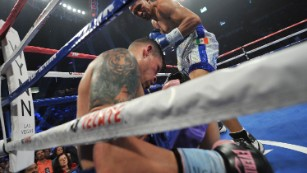 Cruz slumps against the ropes after a knockout punch from Salido.
