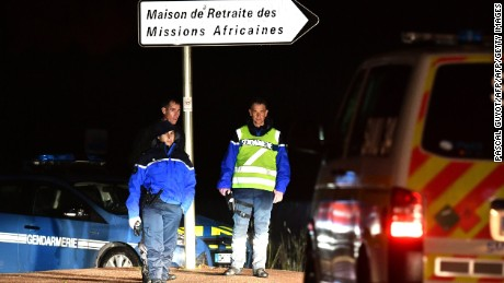 "Gendarmes stand guard on a road near a retirement home for monks in Montferrier-sur-Lez, southern France, early on November 25, 2016, after an armed man burst in the home killing a woman with a knife. Armed police were hunting the man inside the home, which is home to around 70 men and women who have served as missionaries in Africa. Authorities said it was a ""criminal act"". / AFP / PASCAL GUYOT        (Photo credit should read PASCAL GUYOT/AFP/Getty Images)"