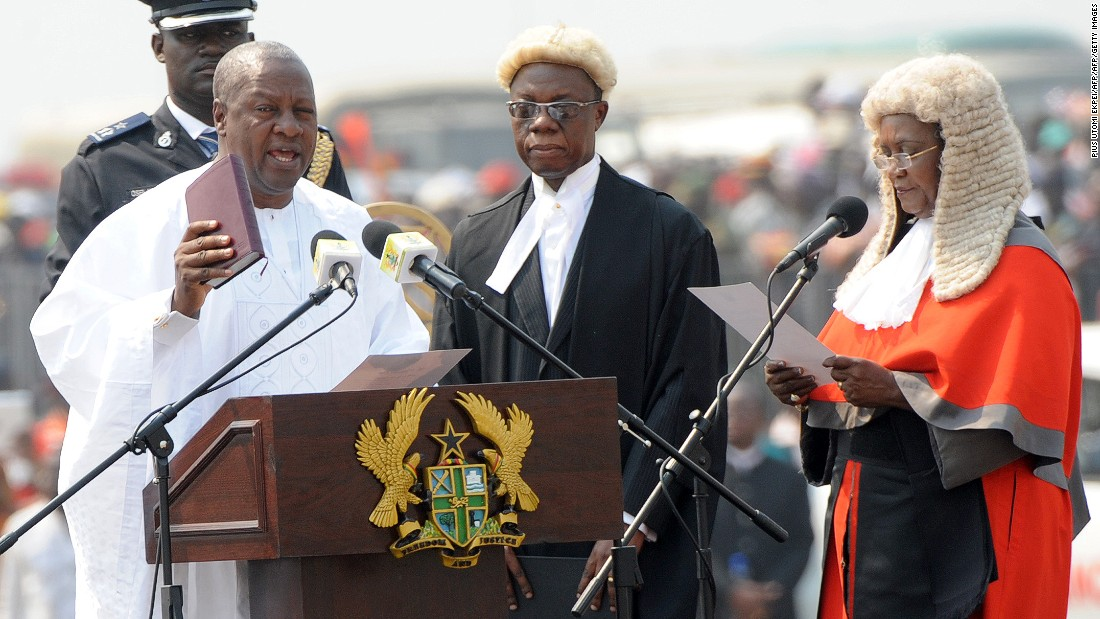 The election is expected to be tight between the ruling National Democratic Congress (NDC) and the largest opposition, New Patriotic Party (NPP). Ghana's current president, John Dramani Mahama, in office since 2012, is seeking re-election.<br /> <br />Pictured: President Mahama takes an oath of office at Independence Square, in Accra, January 2013.<em> </em>Photo Pius Utomi Ekpei/AFP/Getty Images.