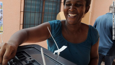 A female voter casts her vote at Santana Video Centre polling station,  in Accra on December 8, 2012.