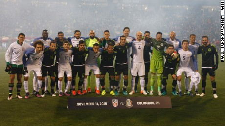 The US and Mexico men's national teams pose for a group photo before a 2018 FIFA World Cup qualifying match in Ohio on November 11, 2016.