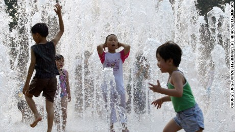 SEOUL, SOUTH KOREA - JULY 21: South Korean children play in the water fountains in front of city hall on July 21, 2005 in Seoul, South Korea. South Korea is set for soaring temperatures this weekend with the hottest day of the year so far predicted. The temperature topped out at 36 degrees Centigrade in the country today. (Photo by Chung Sung-Jun/Getty Images)