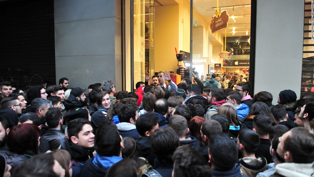 People wait for a department store to open in Thessaloniki, Greece. Long lines snaked outside department stores and roads were blocked near malls as thousands of Greeks joined the country's first-ever Black Friday shopping craze.