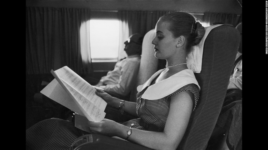 "Aboard a plane, Henderson studies for a musical in 1954. Her big break came in 1951 when she was offered a starring role in the musical ""Oklahoma!"""