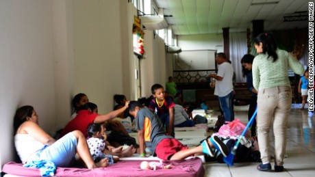 "An evacuated family is seen in the Hostel of the Church Upper Room, in Guapiles, Costa Rica, some 100 km from Limon, on November 23, 2016.  A Caribbean storm verging on a hurricane spun towards the coasts of Costa Rica and Nicaragua on Wednesday, prompting evacuations and red alerts ahead of ""life-threatening"" flash flooding. / AFP / EZEQUIEL BECERRA        (Photo credit should read EZEQUIEL BECERRA/AFP/Getty Images)"