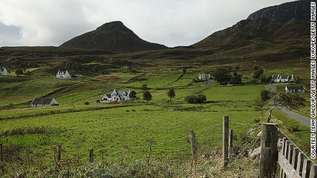 Traditional white Scottish farmhouses, here pictured near The Quiraing in Staffin, Isle of Skye.