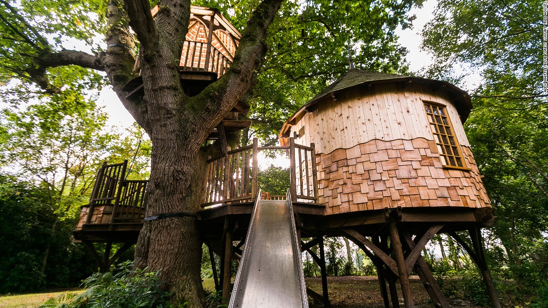 """Timbertop Hangout Treehouse"" is fitted with a crow's nest lookout raised high above, and a stainless steel slide."
