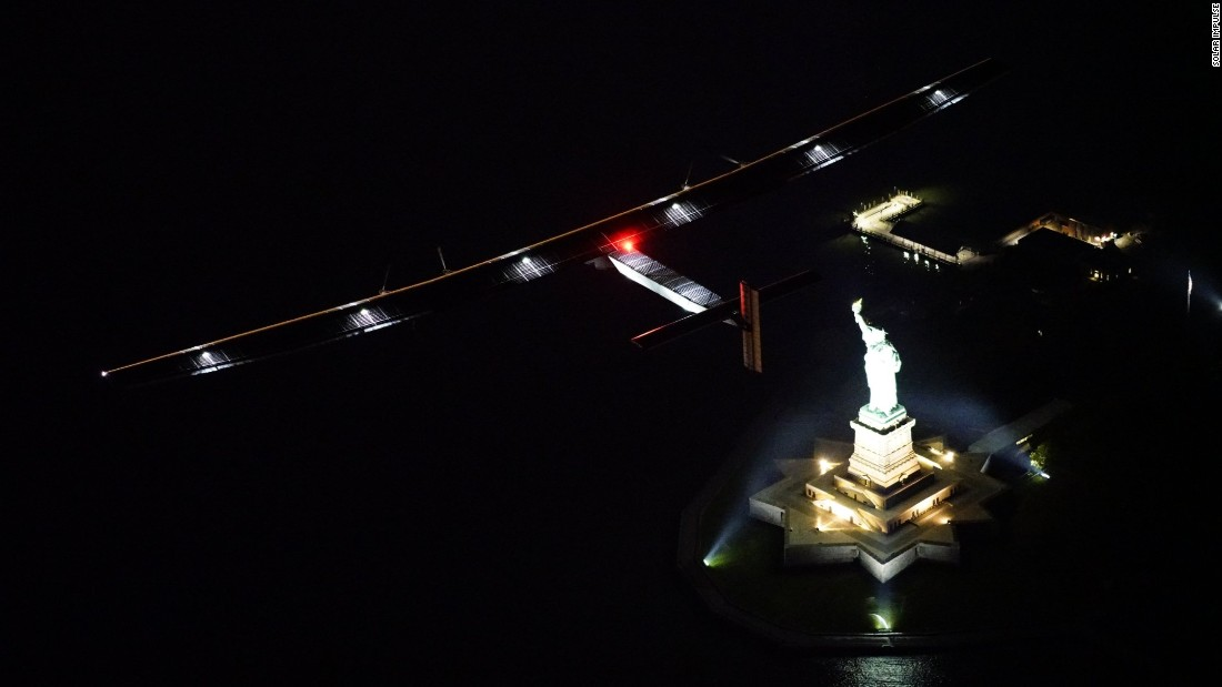 The plane crosses over the Statue of Liberty in New York, the final leg in the United States.
