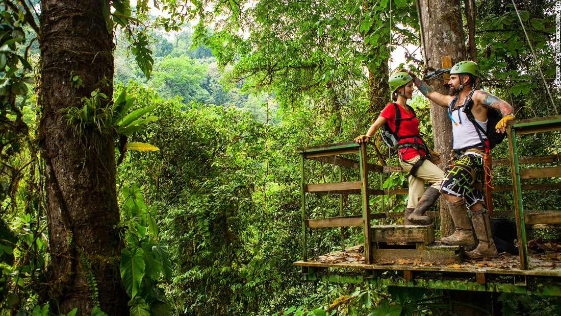 """I used to commute two hours each way in and out of the city in Baltimore and wear a suit everyday and that was very telling as to why I now live in the middle of the rainforest because it drove me crazy,"" says Hogan. Pictured here, Erica and Matt take a break from ziplining in the rainforest.<br />"