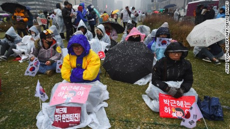 Protesters gather before a mass anti-government rally following presidential scandal in central Seoul on November 26, 2016. Hundreds of thousands of people are expected to take part in street protests across South Korea on November 26 to demand President Park Geun-Hye resign over a corruption scandal or face impeachment. / AFP / JUNG Yeon-Je        (Photo credit should read JUNG YEON-JE/AFP/Getty Images)