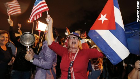 Cuban Americans celebrate upon hearing about the death of longtime Cuban leader Fidel Castro in the Little Havana neighborhood of Miami, Florida on November 26, 2016. Cuba's socialist icon and father of his country's revolution Fidel Castro died on November 25 aged 90, after defying the US during a half-century of ironclad rule and surviving the eclipse of global communism.