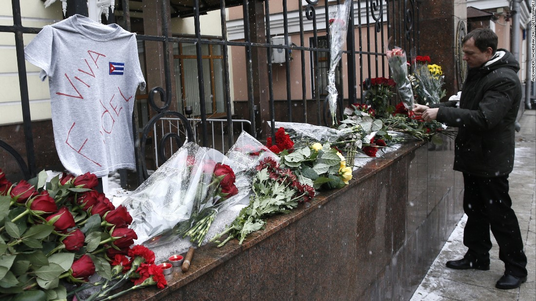 "A man places flowers at the Cuban Embassy in Moscow in memory of Castro on November 26. Russian President Vladimir Putin called the Cuban leader ""a sincere and reliable friend of Russia."""