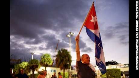 "Hernan Reyes of Miami holds the Cuban flag in celebration of the death of Fidel Castro along ""Calle Ocho,"" or 8th Street, in the Little Havana neighborhood of Miami, Florida. . Mandatory Credit: Dorothy Edwards/Naples Daily News via USA TODAY NETWORK *** Please Use Credit from Credit Field ***"
