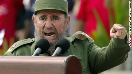 """Habana, CUBA:  Cuban President Fidel Castro presides over a massive May Day demonstration at Havana's Plaza de la Revolucion (Revolution Square), 01 May 2005. A spokesman of Cuban President Fidel Castro read on Cuban National TV a document signed by Castro, 31 July 2006, by which he delegates power to his brother Raul Castro. Fidel Castro underwent surgery shortly after coming back from Mercosur?s Summit in Cordoba, Argentina. """"I do delegate, provisionally, my duties as first secretary of the Central Committee of the Communist Party in Cuba, to the second secretary, comrade Raul Castro Ruz,"""" Castro said. AFP PHOTO/Adalberto ROQUE  (Photo credit should read ADALBERTO ROQUE/AFP/Getty Images)"""