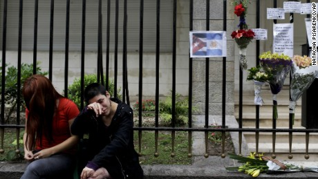 Women cry outside Cuba's embassy in Buenos Aires, Argentina, Saturday, November 26, 2016, after the announcement of the death of Fidel Castro.
