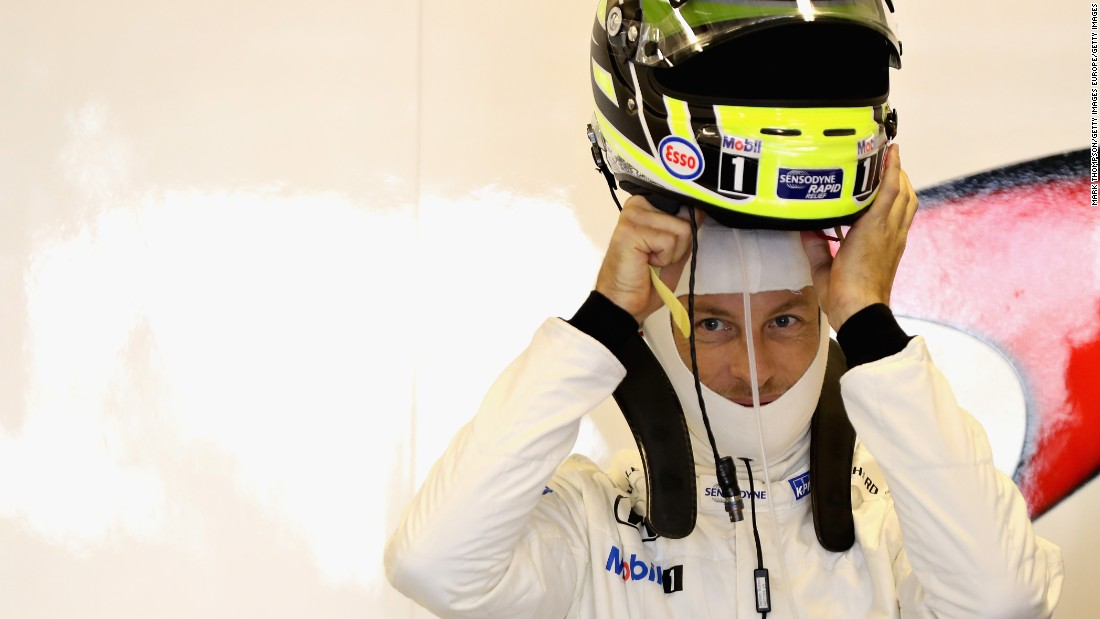 Jenson Button putting on his race helmet for the last time -- the British driver wore the livery of the Brawn team from his championship-winning year in 2009. He was forced to retire on the 12th lap, but McLaren teammate Fernando Alonso finished 10th.