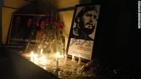 """Lights illuminate a photograph of Fidel Castro at the University of Havana, on Saturday, November 26, where Castro studied before starting the Cuban revolution. """"I am Fidel,"""" students chanted."""