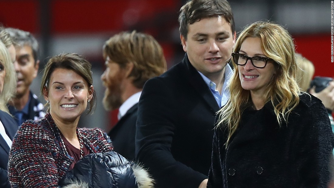 She chatted to Coleen Rooney (left), wife of the England and Manchester United captain Wayne Rooney.