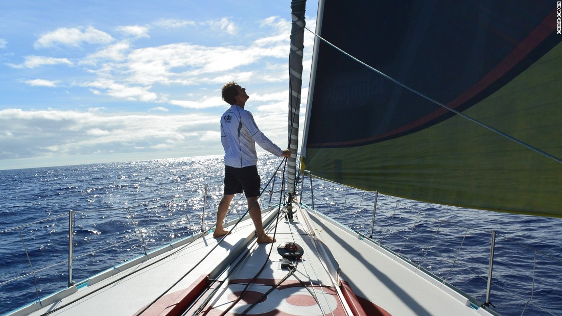 "Colman takes a moment to check the trim of his yacht, which he describes as ""an ambassador for clean energy."""