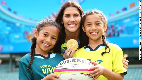 SYDNEY, AUSTRALIA - AUGUST 26: Charlotte Caslick poses for a photo with two young girls during an ARU Sevens media announcement at Allianz Stadium on August 26, 2016 in Sydney, Australia.  (Photo by Mark Nolan/Getty Images)