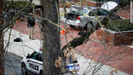 A car inside a police line sits on the sidewalk as authorities respond to an attack on campus at Ohio State University, Monday, Nov. 28, 2016, in Columbus, Ohio. (AP Photo/John Minchillo)