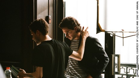 Dolan guides British actor Kit Harington on the set of his latest film