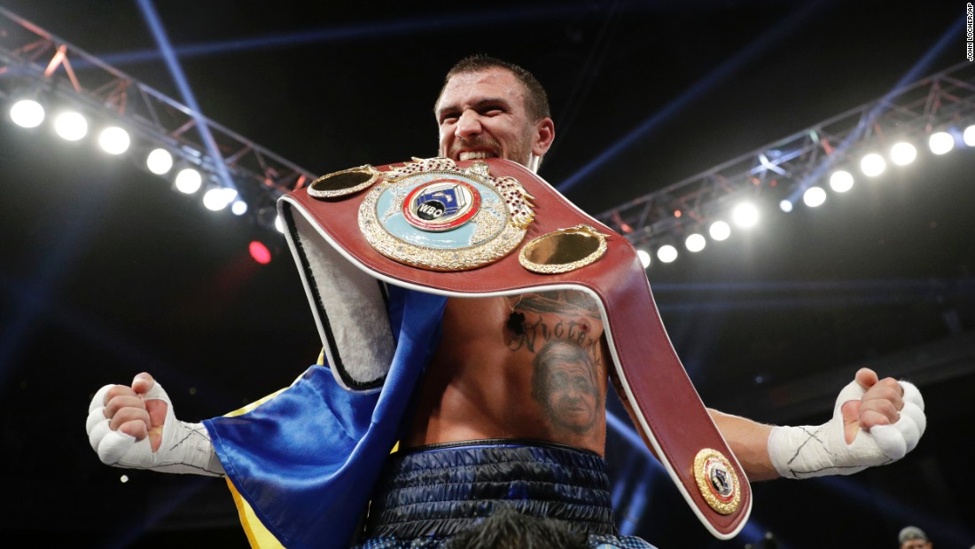 Vasyl Lomachenko celebrates after he successfully defended his junior-lightweight title against Nicholas Walters on Saturday, November 26. The fight in Las Vegas was stopped after the seventh round.