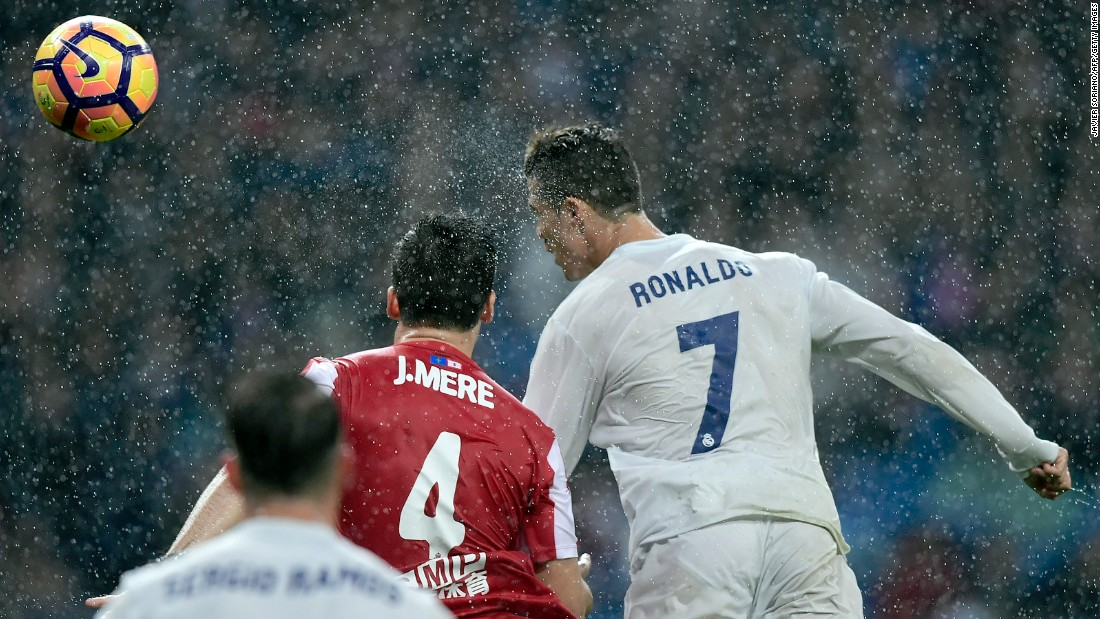Real Madrid star Cristiano Ronaldo heads the ball during a Spanish league match against Sporting Gijon on Saturday, November 26. Madrid won 2-1, with Ronaldo scoring both goals.