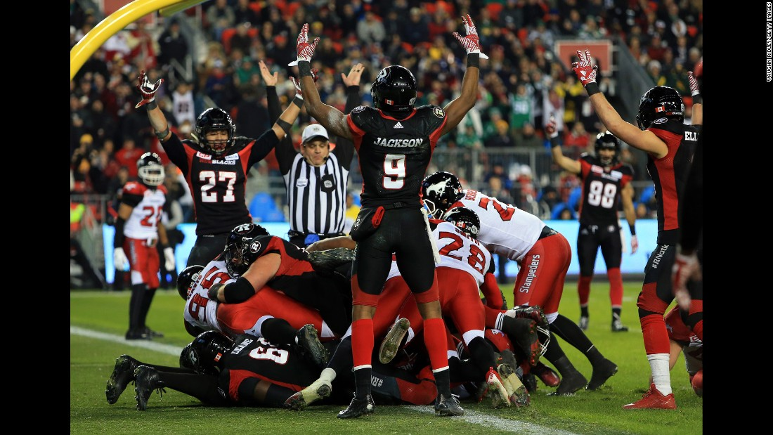 Ottawa players celebrate a second-half touchdown during their Grey Cup victory on Sunday, November 27. Ottawa defeated Calgary 39-33 in overtime for the city's first CFL title since 1976.