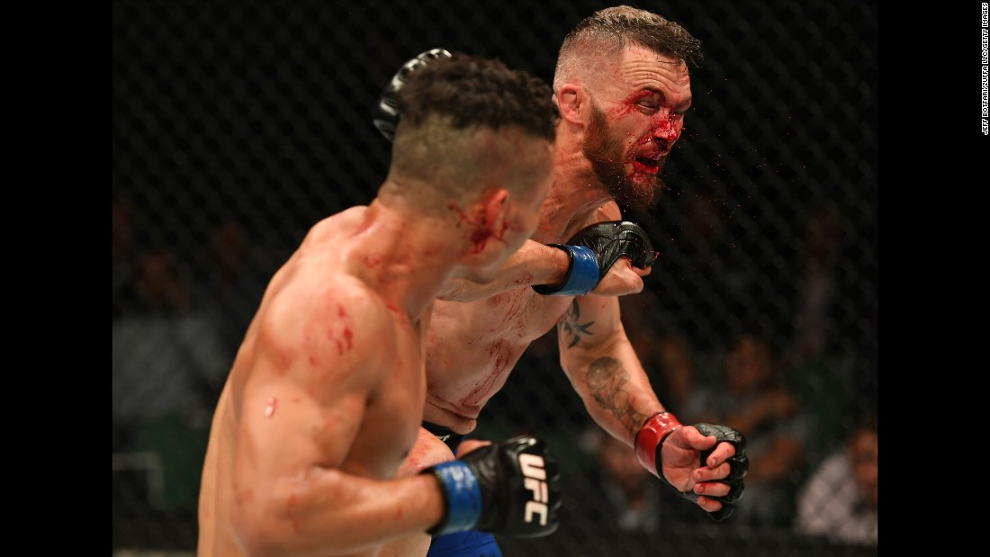 Jon Tuck punches Damien Brown during their UFC lightweight bout in Melbourne on Sunday, November 27. Brown won by split decision.