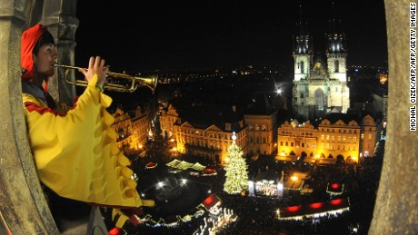 A trumpeter plays during the traditional Christmas tree illuminating and opening of traditional Christmas market in front of the Tyn Church at the Old Town Square on November 26, 2011 in Prague.      AFP PHOTO/ MICHAL CIZEK (Photo credit should read MICHAL CIZEK/AFP/Getty Images)