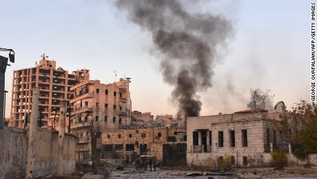 Smoke billows in Aleppo's Bustan al-Basha neighbourhood on November 28, 2016, during Syrian pro-government forces assault to retake the entire northern city from rebel fighters. Government forces have retaken a third of rebel-held territory in Aleppo, forcing nearly 10,000 civilians to flee as they pressed their offensive to retake Syria's second city. In a major breakthrough in the push to retake the whole city, regime forces captured six rebel-held districts of eastern Aleppo over the weekend, including Masaken Hanano, the biggest of those in eastern Aleppo.