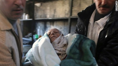 This Sunday, Nov. 27, 2016 photo provided by the Rumaf, a Syrian Kurdish activist group, which has been authenticated based on its contents and other AP reporting, shows two men carry an elderly person out of rebel-held eastern neighborhoods of Aleppo into the Sheikh Maqsoud area that is controlled by Kurdish fighters, Syria. Syrian state media is reporting that government forces have captured the eastern Aleppo neighborhood of Sakhour, putting much of the northern part of Aleppo's besieged rebel-held areas under state control. (The Rumaf via AP)
