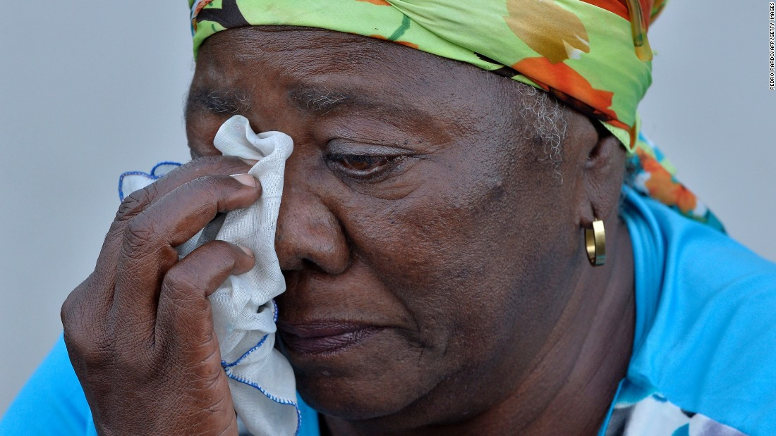 A woman dries her tears as she waits to pay her respects in Havana on November 28.