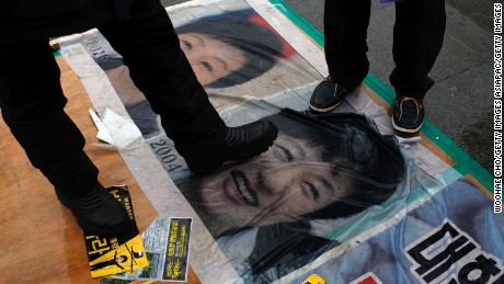 SEOUL, SOUTH KOREA - NOVEMBER 26:  People gathered for a rally against South Korean President Park Geun-hye and step on the Park Geun-hye's portraits on November 26, 2016 in Seoul, South Korea.  Park has recorded worst ever polling figures for the country's presidency after her friend Choi Soon-sil was charged with corrupt influence over state affairs.  (Photo by Woohae Cho/Getty Images)