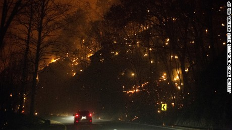 Fires burn on both sides of Highway 441 between Gatlinburg and Pigeon Forge, Tennessee, on Monday, November 28.