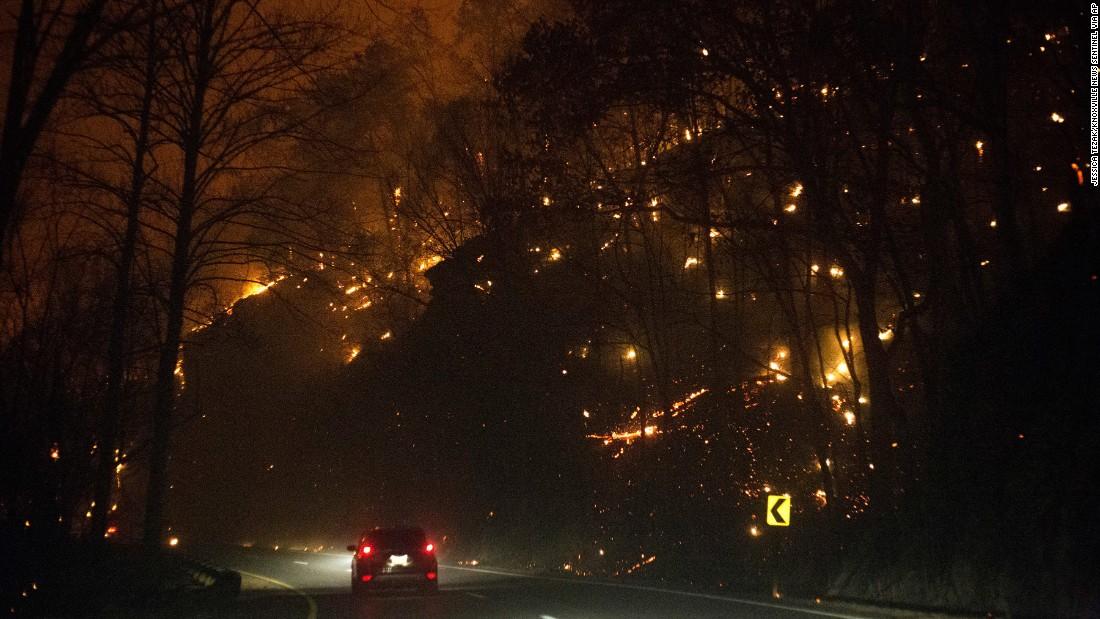 Fires burn on both sides of Highway 441 between Gatlinburg and Pigeon Forge on Monday, November 28.