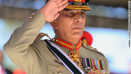 Former Pakistani Army Chief General Ashfaq Parvez Kayani salutes a guard of honor as chief guest during a graduation ceremony for some 64 Sri Lankan army officers in the island nation's central district town of Diyatalawa on June 29, 2013.