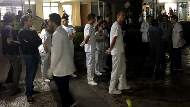 Medical staff members wait for survivors of the plane crash Tuesday at a hospital near Medellin.