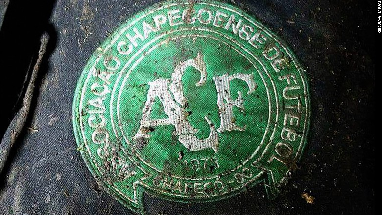 A logo of Brazilian soccer team Chapecoense is found at the site of the plane crash.