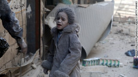 A Syrian girl after airstrikes hit the al-Shear neighborhood in Aleppo on Monday.