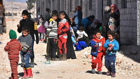 Syrian children displaced from their eastern Aleppo homes at a makeshift camp on Sunday in the government-held district of Jibreen.