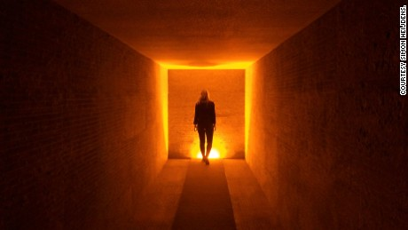 "Designer Simon Heijdens creates compelling site-specific installations. The ""Silent Room"" (pictured here) took the shape of a fully soundproof matte black 40-foot space with one dramatic light source."
