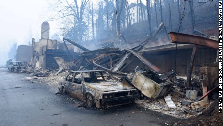 Wildfires have burned businesses and vehicles such as these in Gatlinburg.
