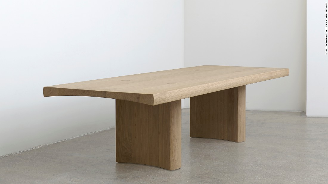 The Hakone Table by London design duo Edward Barber and Jay Osgerby, is on show at Design Miami as part of Galerie Kreo's display. The table, which launched earlier this year during the London Design Festival, is inspired by Japanese carpentry and crafted in oak.