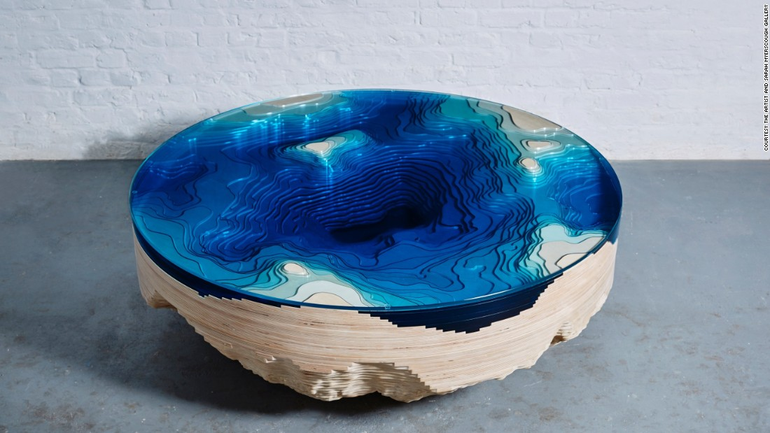 Known for designs that play with the concepts of gravity, geography and illusion, London-based designer Christopher Duffy presents his Abyss Round Table with Sarah Myerscough Gallery at Design Miami this year. Inspired by the depths of the ocean, the table is crafted from wood and glass, arranged like a 3D representation of a geological map.