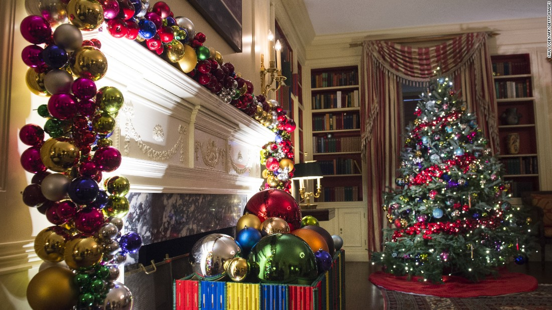 Christmas trees and holiday decorations fill the White House library on November 29, 2016.