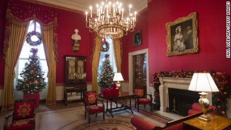 Christmas trees and holiday decorations are seen in the Red Room of the White House in Washington, DC, on November 29, 2016.