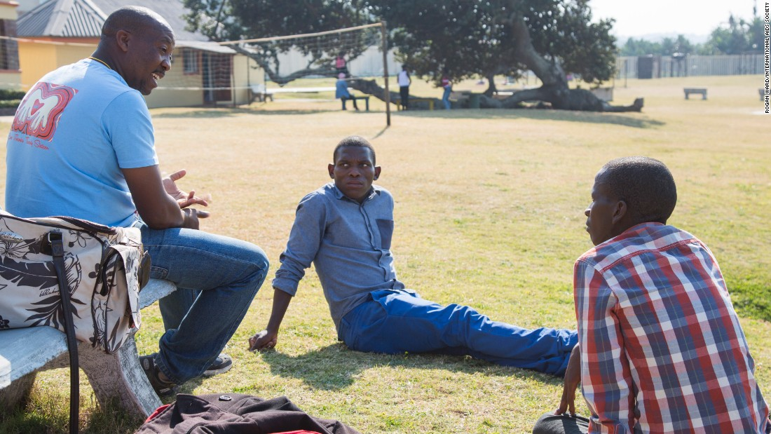 At the Mercury Hibberdene Childrens Camp, teenagers visit once a year from an HIV clinic visit once a year. Sabelo Chonco, center, and Nhlanhla Phewa talk with camp leader Tshepo Tshipe.