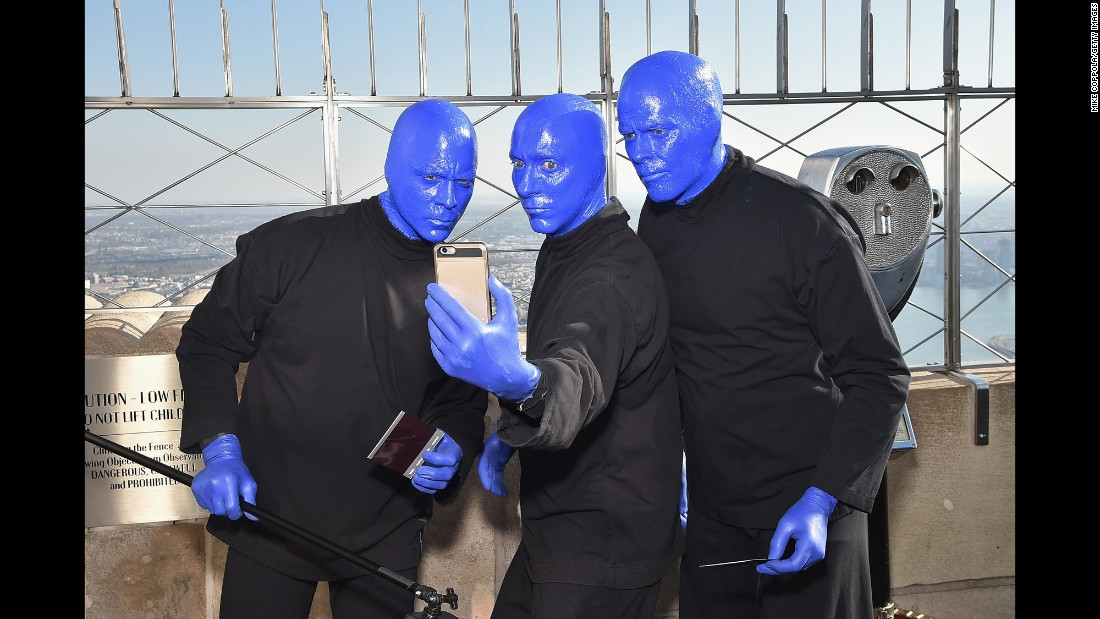 Members of the Blue Man Group pose for a selfie at the Empire State Building as they celebrate their 25th anniversary in New York on Thursday, November 17.